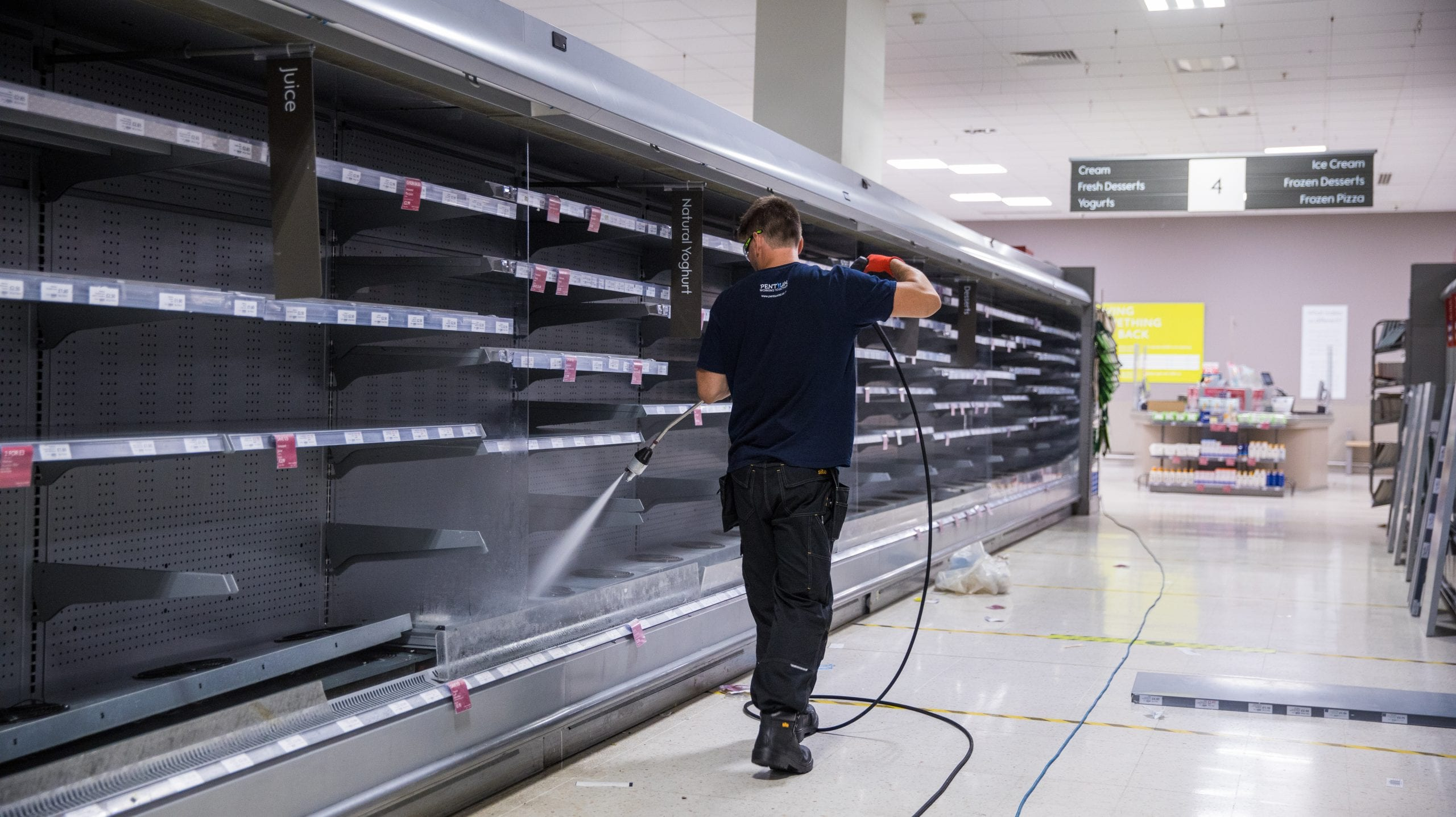 engineer cleaning supermarket case